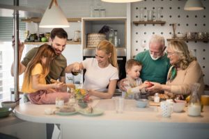 Family together at kitchen island